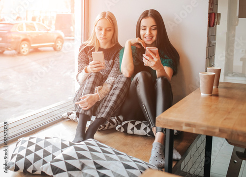 Young caucasian women using phone and saying no to life Canvas Print
