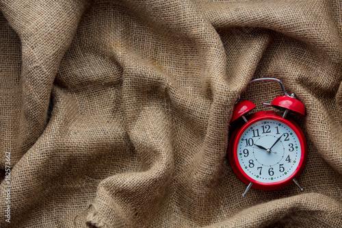 vintage-alarm-clock-on-jute-background