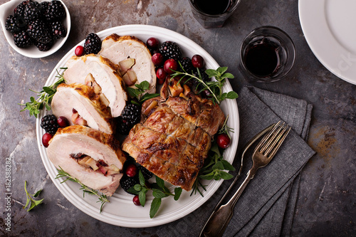 Valokuvatapetti Roasted pork loin stuffed with apple and cranberry