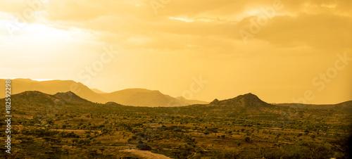 Poster Melon Desert and mountains in the desert near the Ethiopia, Somalia, Djibouti border.