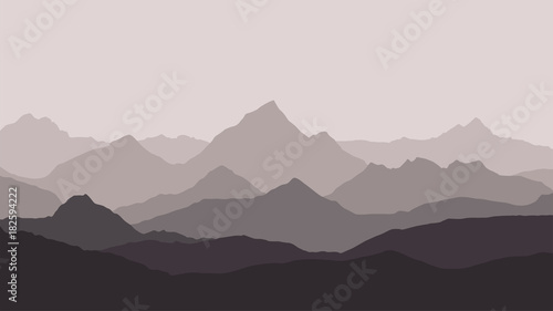Foto op Aluminium Grijs panoramic view of the mountain landscape with fog in the valley below with the alpenglow grey sky and haze background