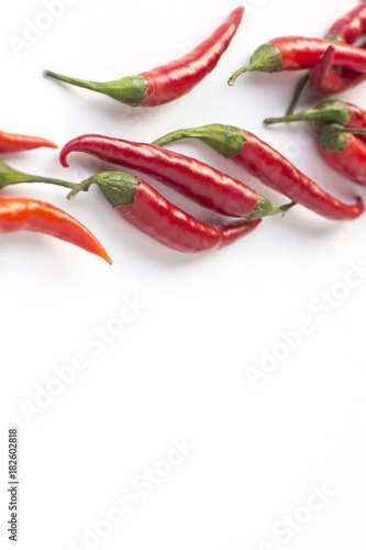 Staande foto Hot chili peppers Red chile peppers on white background. Top view. Vertically
