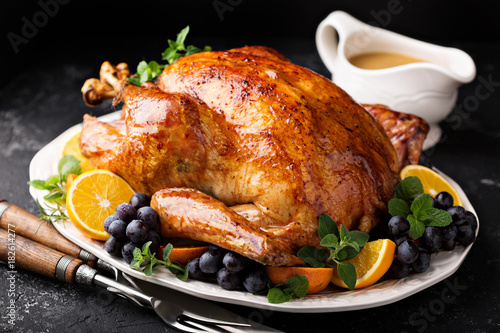 Stampa su Tela  Festive celebration roasted turkey for Thanksgiving