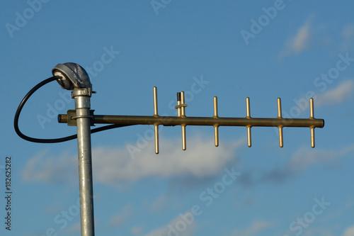 Fototapeta UHF yagi antenna used for digital telemetry data as late afternoon sun setting g