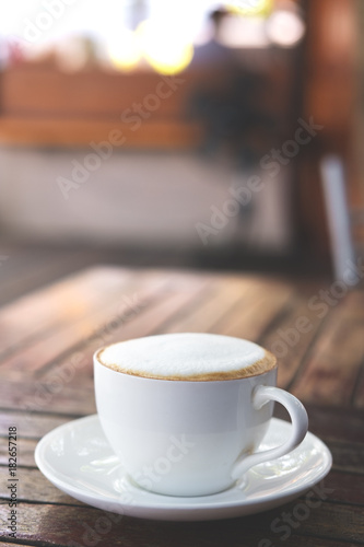 Wall Murals Cafe Hot coffee on wooden table