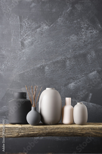 Photo  Various vases on wooden shelf