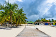 wooden bridge juts out into of the sea Dominican Republic