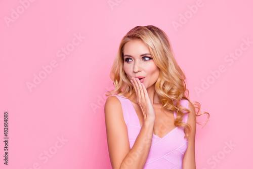 Fotografija  Oops! Close up portrait of sexy, beautiful, impressed, amazed blonde girl holdin