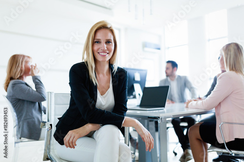 Valokuva  Picture of attractive saleswoman on meeting in office