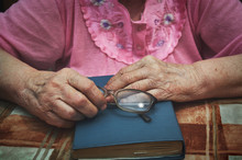 Senior Woman's Hands Holding A...