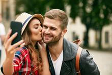 Lovely Tourist Couple Taking P...