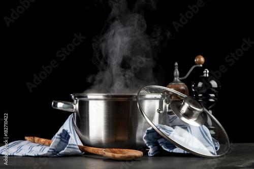 Fotografie, Obraz  Steaming pot on black background