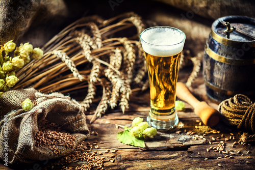 Autocollant pour porte Biere, Cidre Glass of fresh cold beer in rustic setting. Food and beverage background