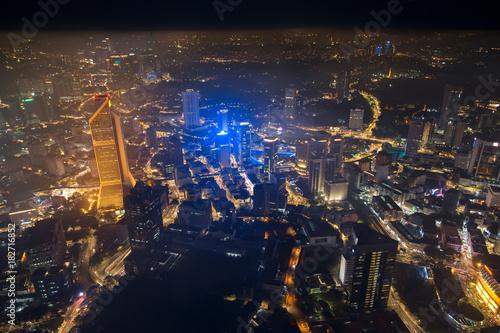 Photo Stands Kuala Lumpur Business skyscrapers night downtown background. Aerial skyline view to Kuala Lumpur city, Malaysia