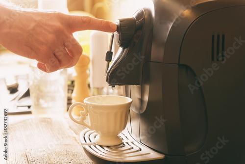 Coffee machine making coffee Fotobehang