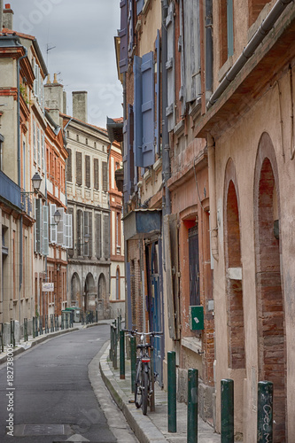 Beautiful narrow street in the city center of Toulouse, France