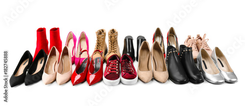 Different female shoes on white background