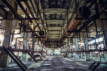 Ruins Of Abandoned Industrial Factory, Large Warehouse Or Hangar Building With Rusty Equipment And Machine Tools