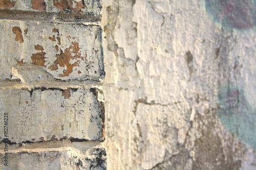 Fotobehang Oude vuile getextureerde muur very old a battered and worn brick wall