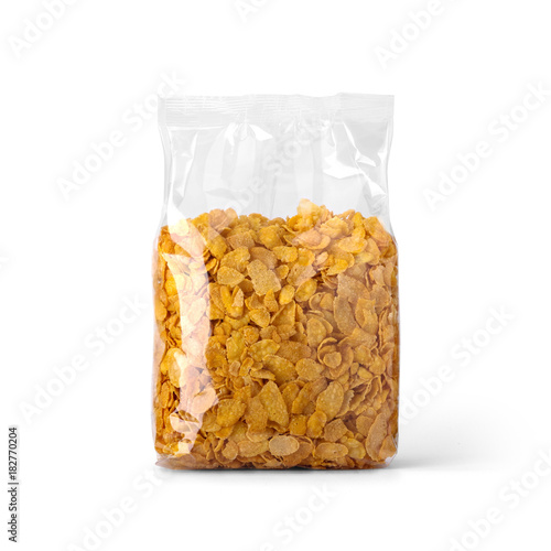 Corn flakes in transparent plastic bag isolated on white background Fototapeta