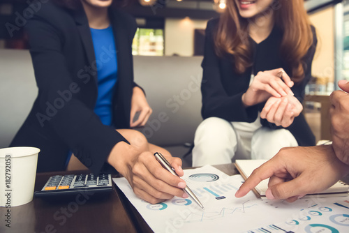 Financial adviser working with clients analyzing data at the table Canvas Print