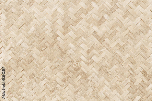 Fotografía  Old bamboo weaving pattern, woven rattan mat texture for background and design art work