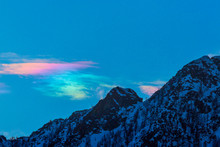 Cloud With Natural Circumhorizontal Arc And Mountain Peak In Winter