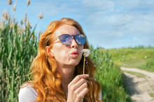 Red-haired Girl In Sunglasses ...