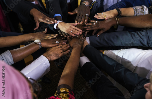 Photo  A Group of International Business People Are Putting Their Hands Together