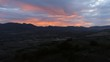 Sunset Over Arable Farms and Mountainous Landscape