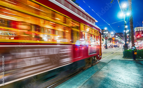 NEW ORLEANS - FEBRUARY 11, 2016: New Orleans streetcar at night, blurred view Canvas Print