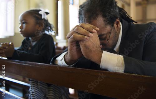 Fotografia, Obraz Religious man praying inside a church