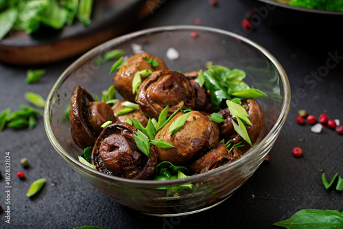 Spoed Foto op Canvas Natuur Baked mushrooms with soy sauce and herbs
