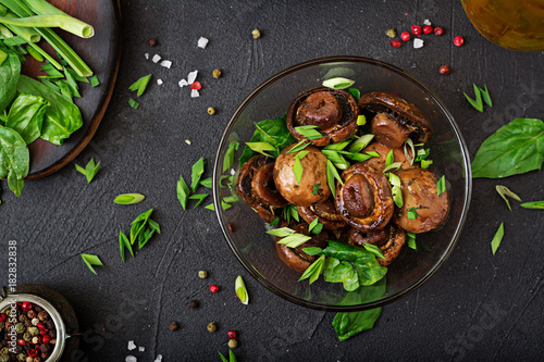 Spoed Foto op Canvas Natuur Baked mushrooms with soy sauce and herbs. Top view