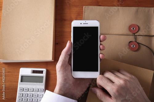 Fotografie, Obraz  スマホを操作するビジネスマン
