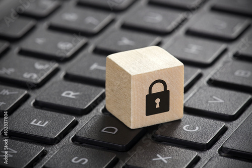 Fotomural Wooden block with lock graphic on laptop keyboard