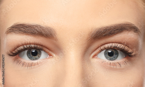 Fényképezés  Beautiful female eyes with long eyelashes, closeup