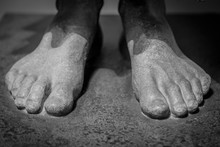 Feet Of An Ancient Statue