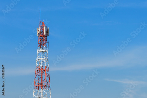High antenna tower pillar of cellular communication on the blue sky