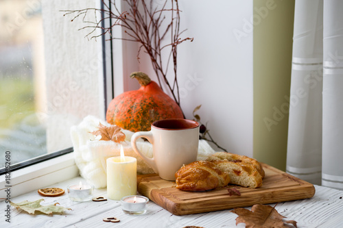 Cup of tea and bread near the window. Lifestyle of the autumn. Pumpkin
