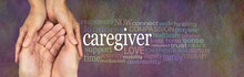 For All The Wonderful Caregivers Out There - Female Hands Gently Cupped Around Male Cupped Hands Beside A CAREGIVER Word Cloud On A Rustic Stone Background