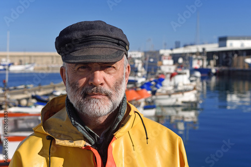 Obraz portrait of a fisherman in the harbor - fototapety do salonu