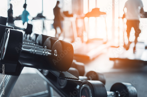 Fotografija  Rows of dumbbells in the gym with hign contrast and monochrome color tone