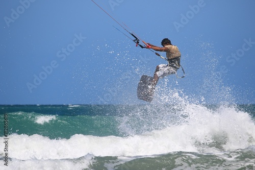 kitesurfer flies out of the water