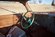 Old Battered Steering Wheel In...