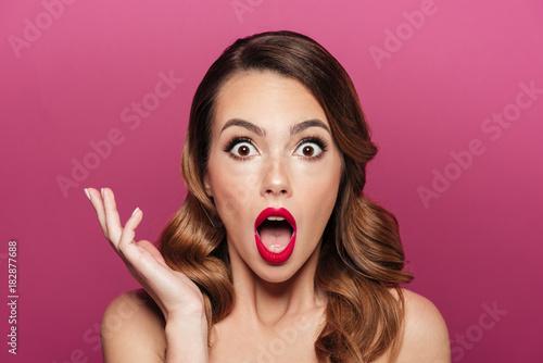 Valokuva  Shocked beautiful lady with make up looking camera