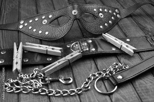 Fotografie, Tablou  BDSM fetish sex toys bondage composition: leather mask, chain, neck collar, blac
