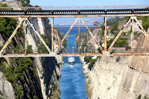 Fototapeta Corinth channel in Greece view on Aegean Sea while a ship is going to pass the c