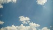 Clouds are moving in the blue sky. TimeLapse. Beautiful White fluffy clouds over blue sky soar in Time lapse.