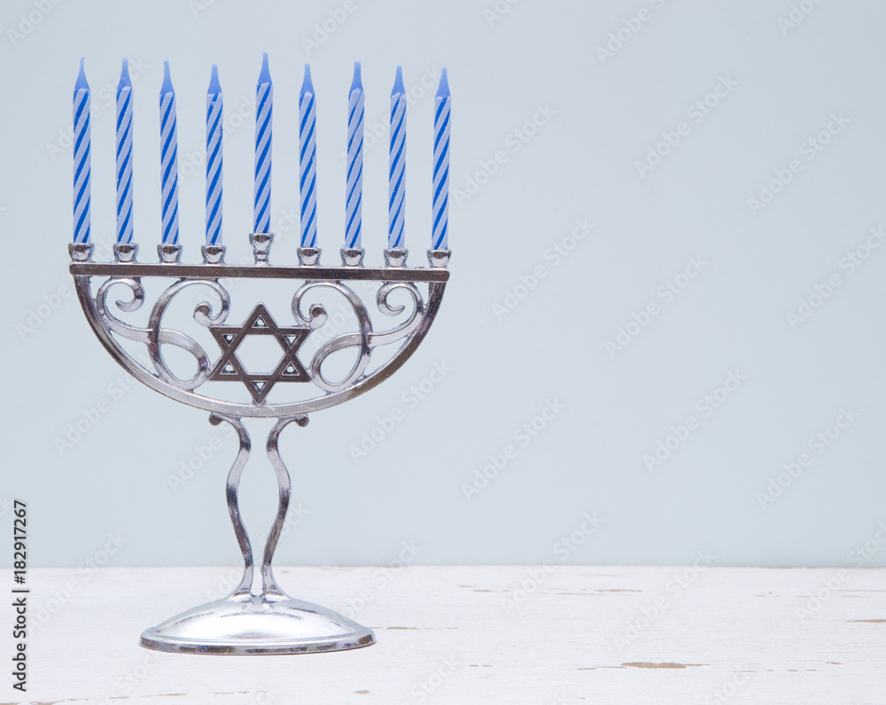 Photo  Hanukkah Menorah with a Simple Blue Background on a Distressed Wooden Table